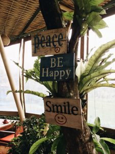 be happy and peace sign