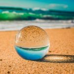 close-up-crystal-ball-on-sand