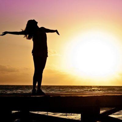 joyous woman at sunset